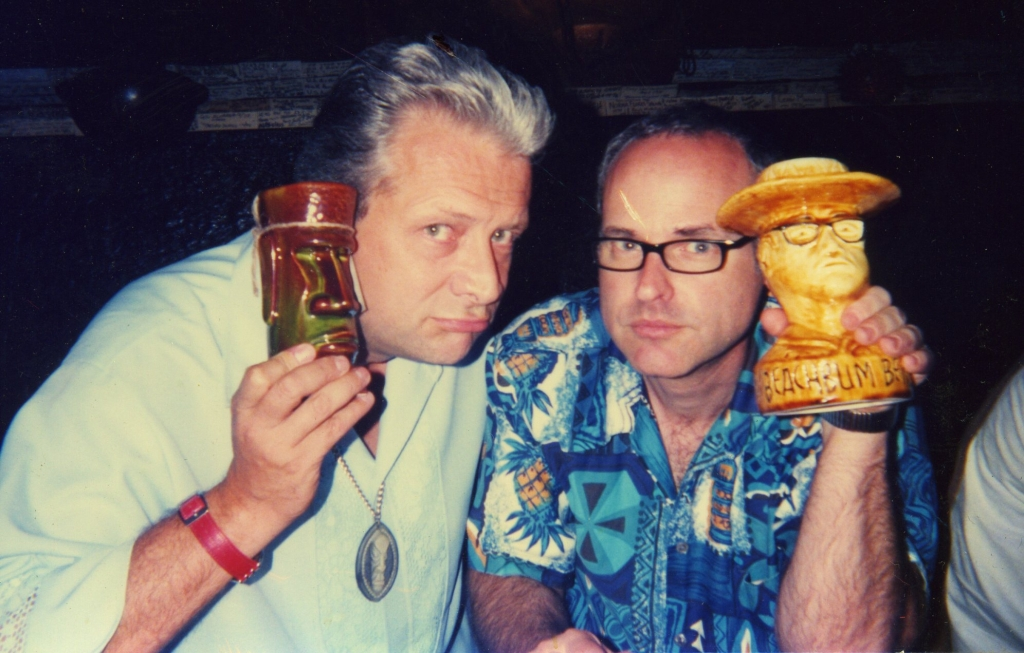 "Sven Kirsten and Jeff ""Beachbum"" Berry holding up Tiki mugs"